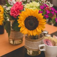 Sunflower in mason jar. Coffee shop bridal shower. Bridesmaidsconfession.com