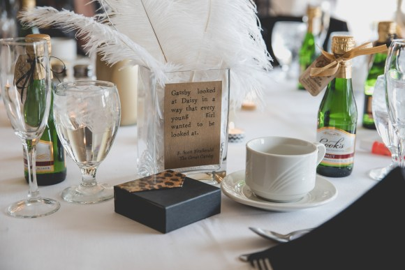 Feather centerpieces and daisy quote. Great Gatsby Bridal Shower. Bridesmaidsconfession.com