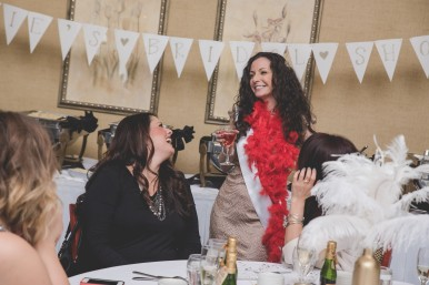Bride wearing red feathered boa. Great Gatsby Bridal Shower. Bridesmaidsconfession.com