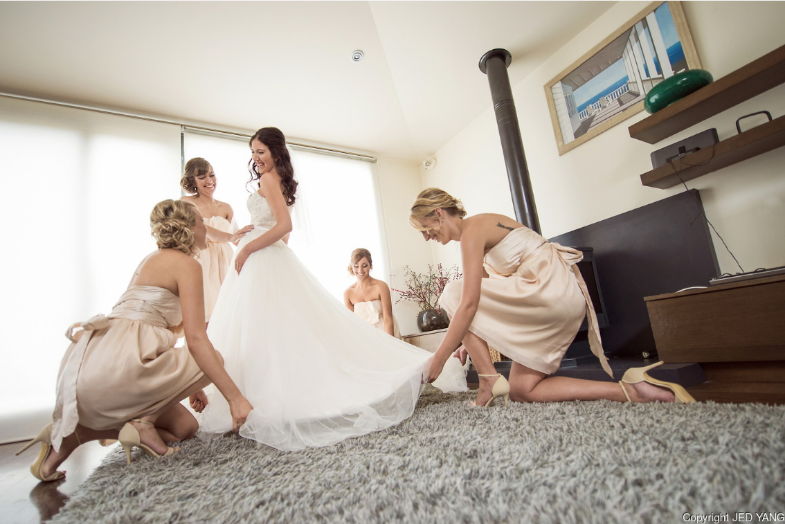Getting Ready Bridesmaids Fixing Dress Royal Swan Photography bridesmaidsconfession.com