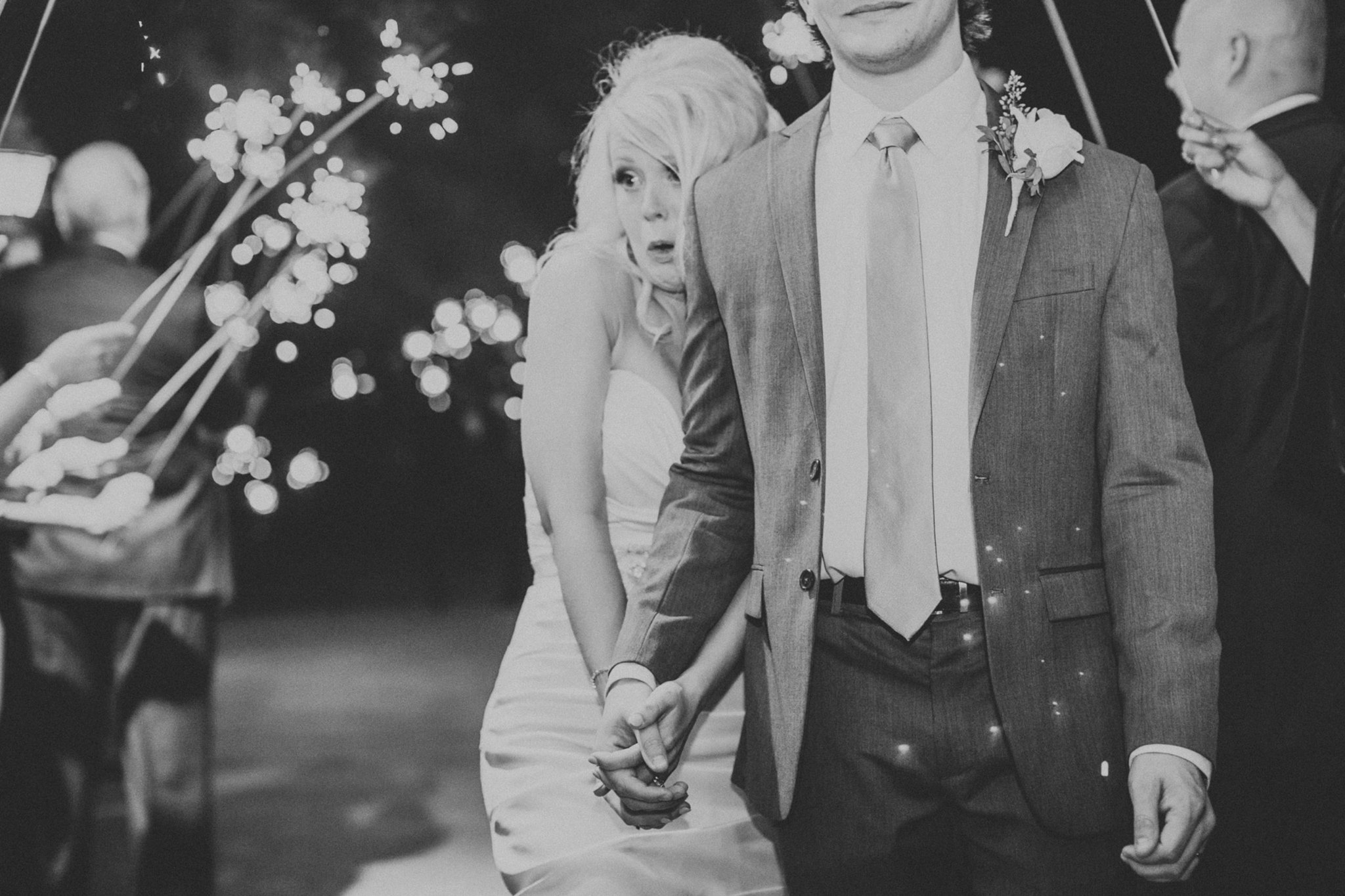 Bride scared of sparkler exit. Funny wedding photos. Four Corners Photography. bridesmaidsconfession.com