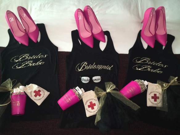 bridesmaids-and-bridesbabes-shirts-in-black-and-gold-with-pink-high-heels-to-make-hte-outfit-pop-brides-babes